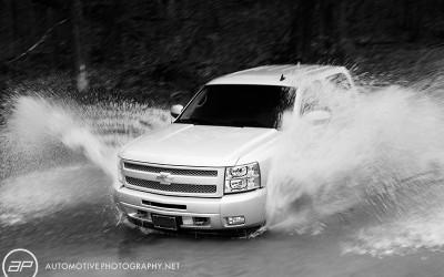 Chevy Truck Driving Through River